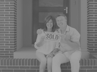 "Real estate, people holding ""sold"" sign"